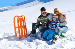 Family having fun on fresh snow at winter Stock Photography