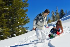 Family having fun on fresh snow at winter Royalty Free Stock Photos