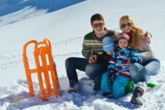 Family having fun on fresh snow at winter vacation Royalty Free Stock Images
