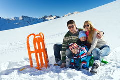 Family having fun on fresh snow at winter vacation Royalty Free Stock Photos