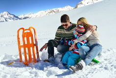 Family having fun on fresh snow at winter vacation Royalty Free Stock Photography