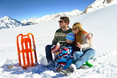 Family having fun on fresh snow at winter vacation Stock Image