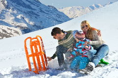 Family having fun on fresh snow at winter vacation Stock Images