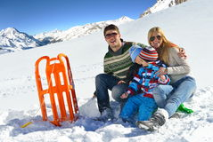 Family having fun on fresh snow at winter vacation Royalty Free Stock Photo