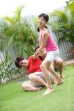 Family having fun in the garden Stock Photography