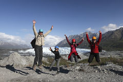 Family is having fun on glacier Royalty Free Stock Photography