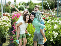 Family having fun with in a greenhouse. Happy family having fun with in a greenhouse Stock Photo