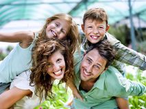 Family having fun in a greenhouse Stock Images