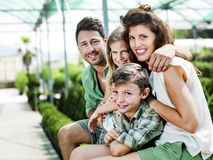 Family having fun in a greenhouse. Happy family having fun in a greenhouse Stock Photography