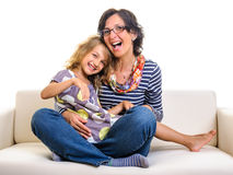 Family having fun at home mother and girl Stock Images