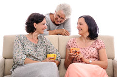 Family having fun at home senior lady listening funny story Royalty Free Stock Photos