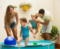 Family having fun in kids pool Royalty Free Stock Photos