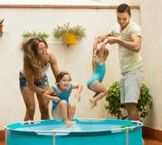 Family having fun in kids pool Stock Photo