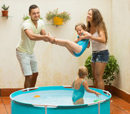 Family having fun in kids pool Stock Image