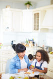 Family having fun in kitchen Stock Photography