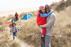 Family Having Fun With Kite In Sand Dunes. At Camera Royalty Free Stock Photography