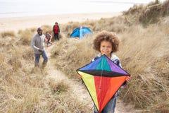 Family Having Fun With Kite In Sand Dunes. Having Fun Stock Photos