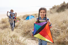 Family Having Fun With Kite In Sand Dunes. At Camera Royalty Free Stock Images