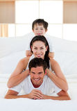 Family having fun lying. On the bed Royalty Free Stock Images