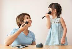 Family having fun with makeup. stock photos