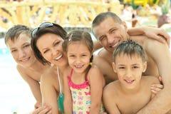 Family having fun near pool. Happy family having fun near a pool Royalty Free Stock Images