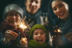 Family having fun on New Year stock photography