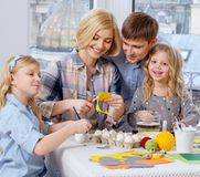 Family having fun painting and decorating easter eggs. Stock Photo