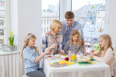 Family having fun painting and decorating easter eggs. Stock Photography