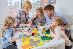 Family having fun painting and decorating easter eggs. Stock Image