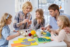 Family having fun painting and decorating easter eggs. Stock Images