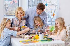 Family having fun painting and decorating easter eggs. Royalty Free Stock Images