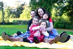 Family having fun in the park. Stock Photo