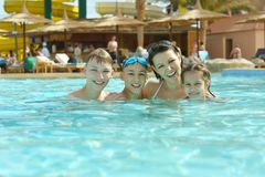 Family having fun in pool. Happy family having fun in a pool Royalty Free Stock Photos