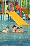 Family having fun in pool Stock Photo