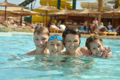 Family having fun in pool. Happy family having fun in a pool Stock Images