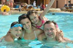 Family having fun in pool. Happy family having fun in a pool Stock Image