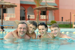 Family having fun in pool Royalty Free Stock Photography