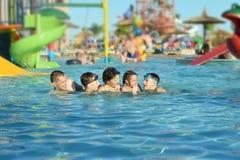 Family having fun in pool Stock Photography
