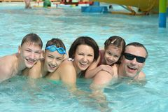 Family having fun in pool Stock Photography