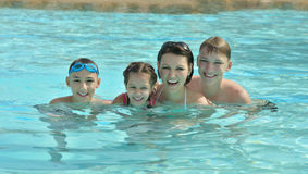 Family having fun in pool. Portrait of a happy family having fun in pool Stock Photo