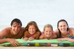 Family Having Fun In Sea On Airbed Stock Photo