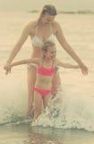 Family having fun in the sea. Stock Photos