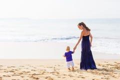 A family is having fun at the seashore Royalty Free Stock Photos