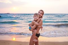 A family is having fun at the seashore Stock Images