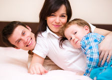 Family is having fun. While sitting on a couch Royalty Free Stock Image