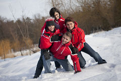 Family is having fun in the snow royalty free stock photos