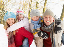 Family Having Fun Snowy Woodland Stock Image