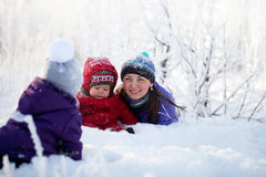 Family Having Fun in Snowy Woodland Stock Image