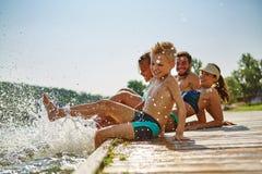 Family having fun and splashing water Royalty Free Stock Photos