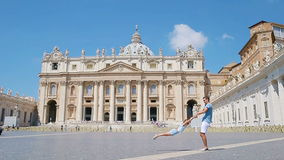 Family having fun at St. Peter`s Basilica church in Vatican city, Rome. Happy travel father and little girl on european. Happy family in Vatican city and St stock video footage
